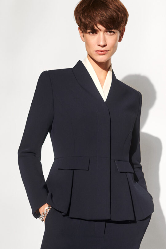 https://thefoldlondon.com/wp-content/uploads/2018/08/191028_THE_FOLD_LE_MARAIS_PEPLUM_JACKET_NAVY_LE_MARAIS_CIGARETTE_TROUSER_NAVY_BOWERY_BLOUSE_IVORY_144_v2.jpg
