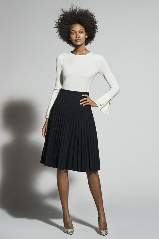 https://thefoldlondon.com/wp-content/uploads/2018/12/KIELDER-SILK-CUFF-JUMPER-IVORY-DK030_ALVERSTON-SKIRT-BLACK-DS012_10807_v2.jpg