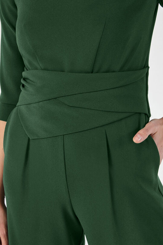 https://thefoldlondon.com/wp-content/uploads/2015/08/LUGANO_JUMPSUIT_GREEN_DD199_DETAIL_45026-1.jpg