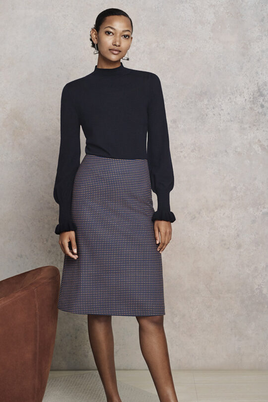 https://thefoldlondon.com/wp-content/uploads/2017/09/Orta_Frill_Cuff_Jumper_Navy_Merino_DK008003_Edington_Skirt_Navy_Spot_Jacquard_DS011_0868.jpg