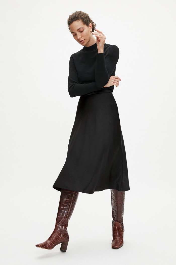 https://thefoldlondon.com/wp-content/uploads/2020/08/TheFold_KELMORE_MIDI_SKIRT_BLACK_DS034_044_v2.jpg