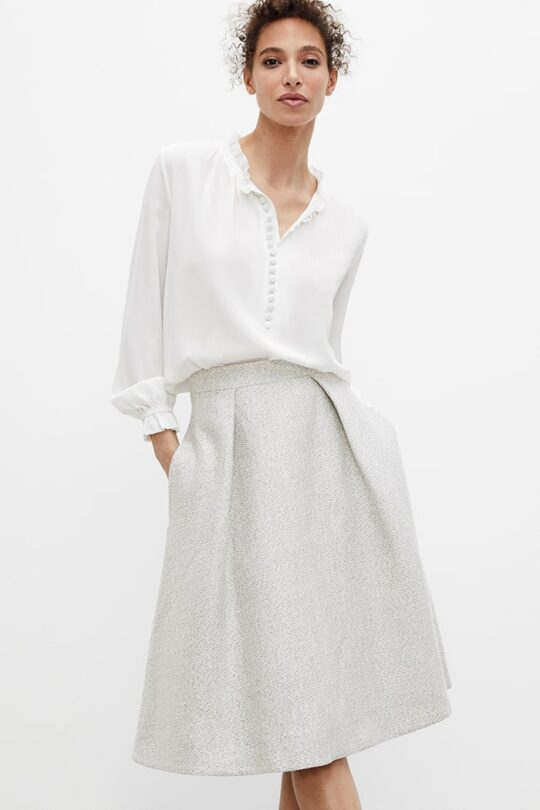 https://thefoldlondon.com/wp-content/uploads/2021/02/TheFold_Blenheim_Skirt_Ivory_And_Silver_Grey_Tweed_DS053_2103_2_v2.jpg