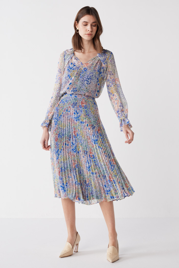 https://thefoldlondon.com/wp-content/uploads/2021/03/TheFold_Avebury_Skirt_Multi_Meadow_Print_Pleated_Chiffon_DS062_2104_2_v2.jpg