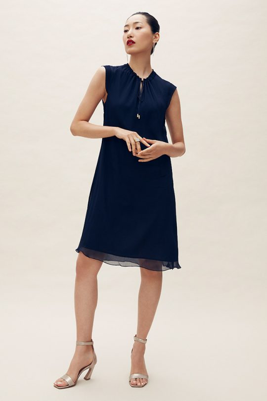 https://thefoldlondon.com/wp-content/uploads/2021/04/TheFold_Andeville_Dress_Navy_Crinkled_Georgette_DD204_2105_1_v2.jpg